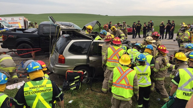 Firefighters assist victims of a two-vehicle crash in New Tecumseth on June 17, 2017. (Peel Paramedics)